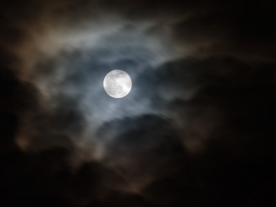 Full Moon and Passing Clouds at Night by Adam Jones; in association with Art.com
